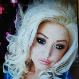 Lucy Floyd as Dolly Parton