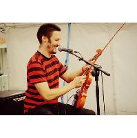 Violinist. Rapper. Menace. Mike Dennis.